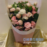 A gentle mix of flowers. The different shades of pink in the roses and lisianthus create a nice effect.
