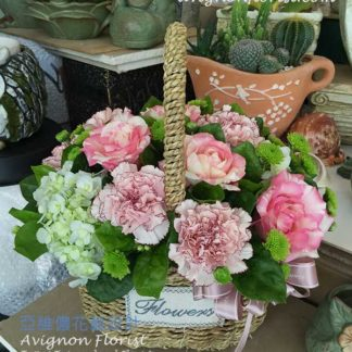Carnations Hydrangea and Roses in a basket